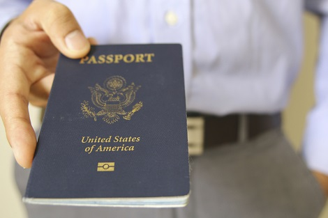 Hand Holding an American Passport Isolated